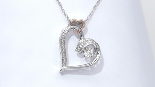 0fd41592a56e Video  ZALES Unstoppable Love Diamond Accent Double Heart Necklace in  Sterling Silver and 10K Rose Gold